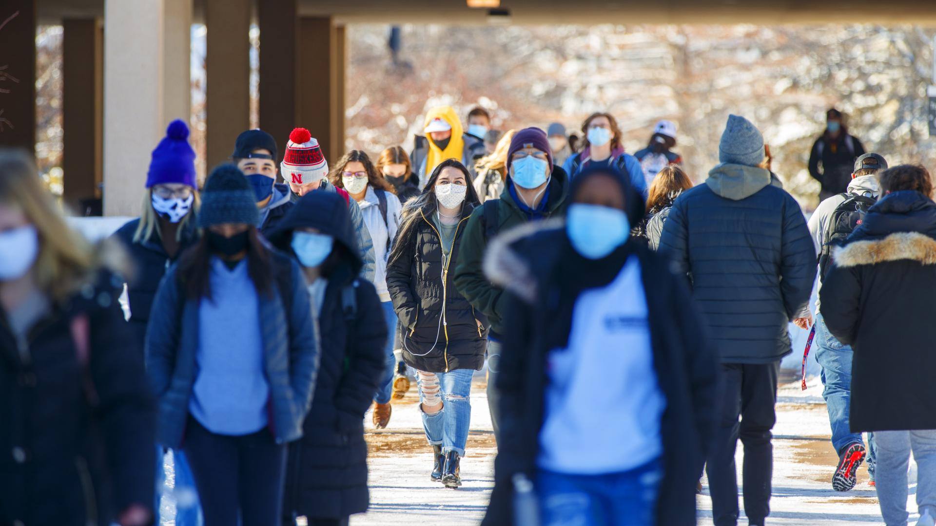 Students walk by Love Library on the first day of classes for Spring 2021