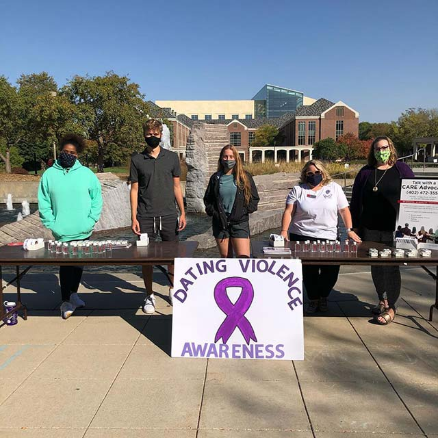 CARE tabling on plaza for Domestic Violence Awareness Month