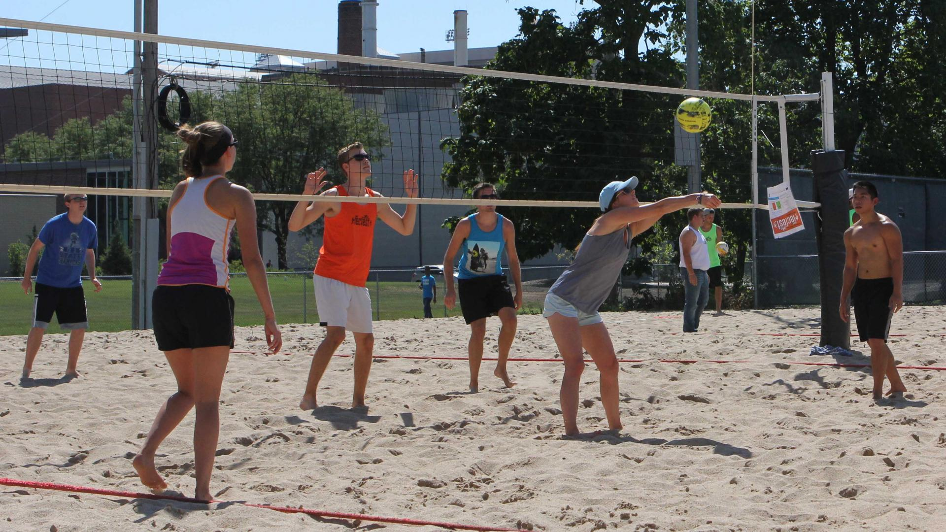 Students play intramural sand volleyball