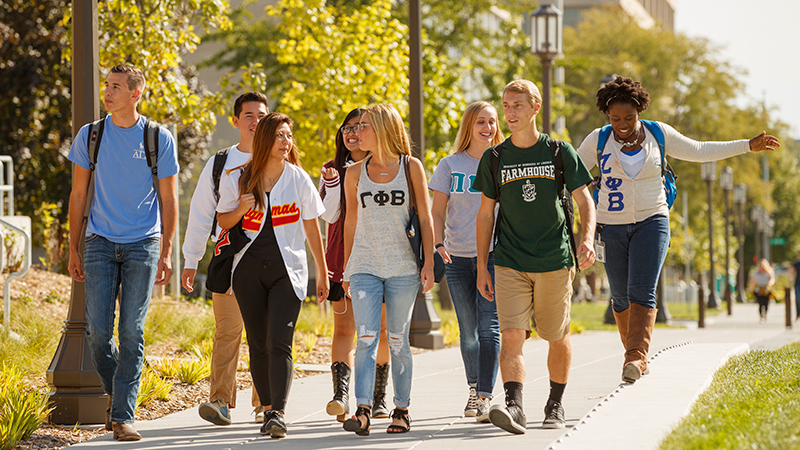 Members of fraternities and sororities walk across campus at the University of Nebraska-Lincoln