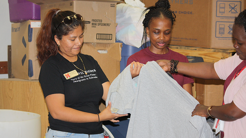 Students volunteer by sorting clothing for the Homeless Prevention Coaltion