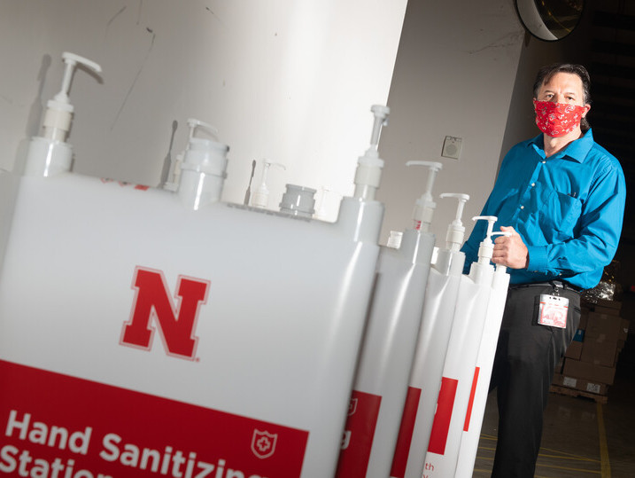 Jim Jackson, associate vice chancellor of University Operations, put a team together to solve the problem of efficiently distributing hand sanitizer across campus. They invented the large-capacity, free-standing dispenser station shown here.