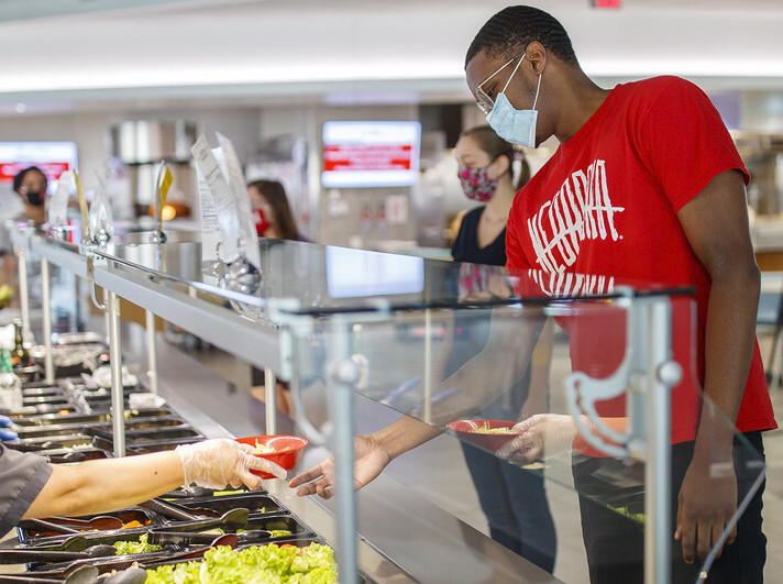 All masked up, students make lunch selections in the Cather Dining Center earlier this summer.