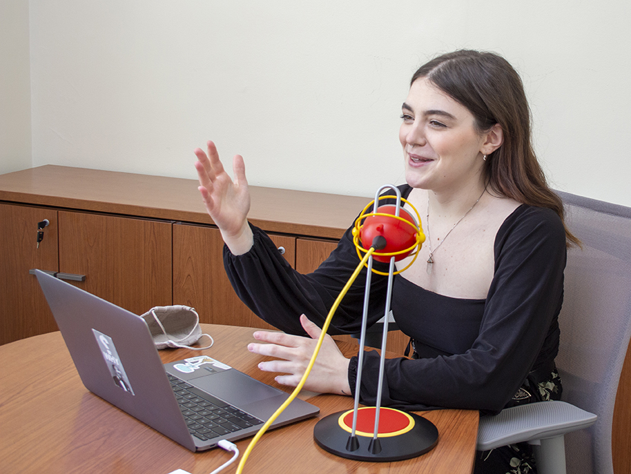 """Lizzy Lavin gestures with her hands while recording an episode of the podcast """"What You Missed At The Women's Center"""" with co-host Syrah Andrews. [photo by Mike Jackson   Student Affairs]"""
