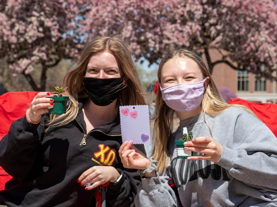 Students participate in campus events with friends.