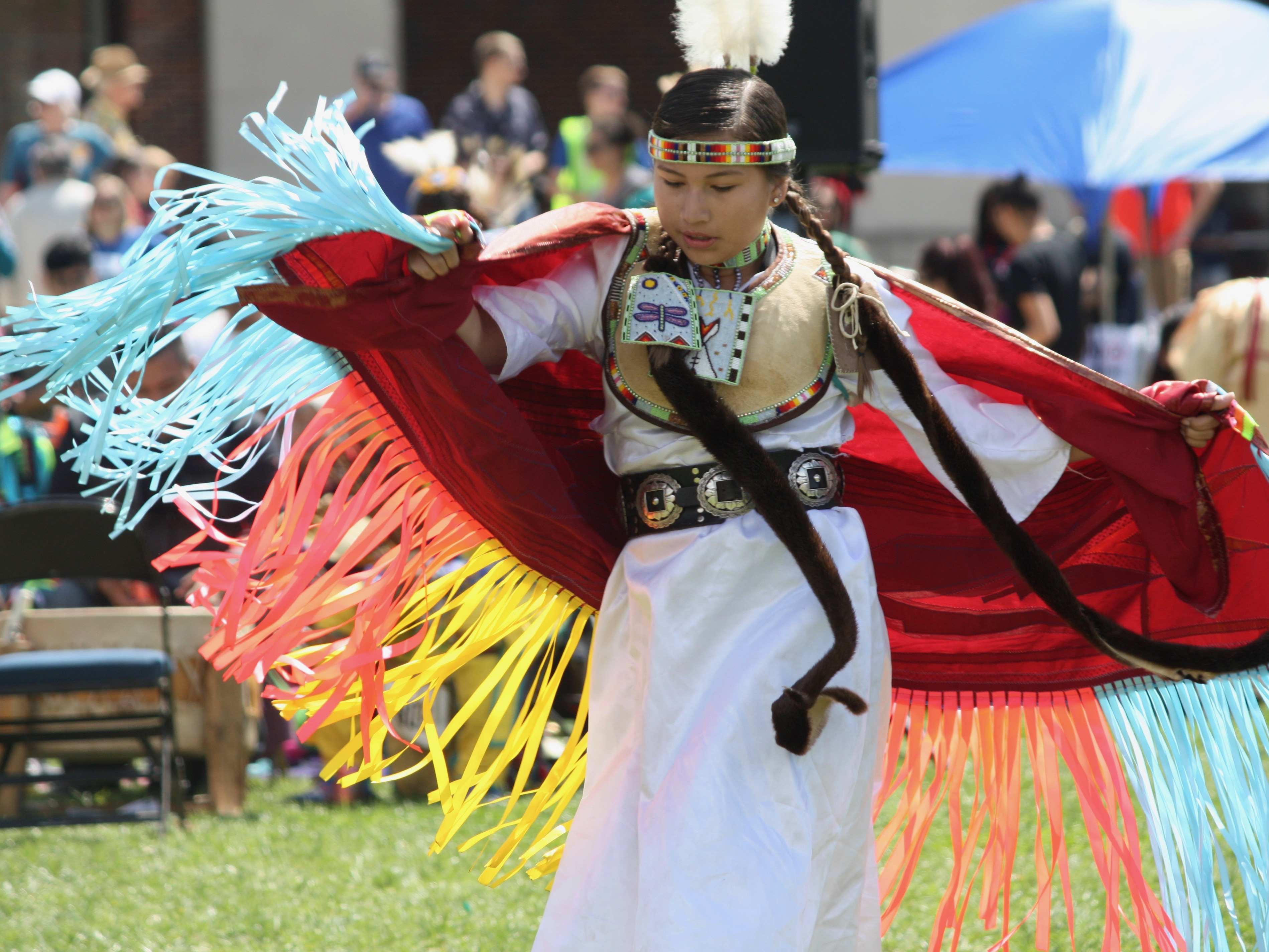 Native American dancer performs on the University of Nebraska-Lincoln green space at the UNITE powwow.