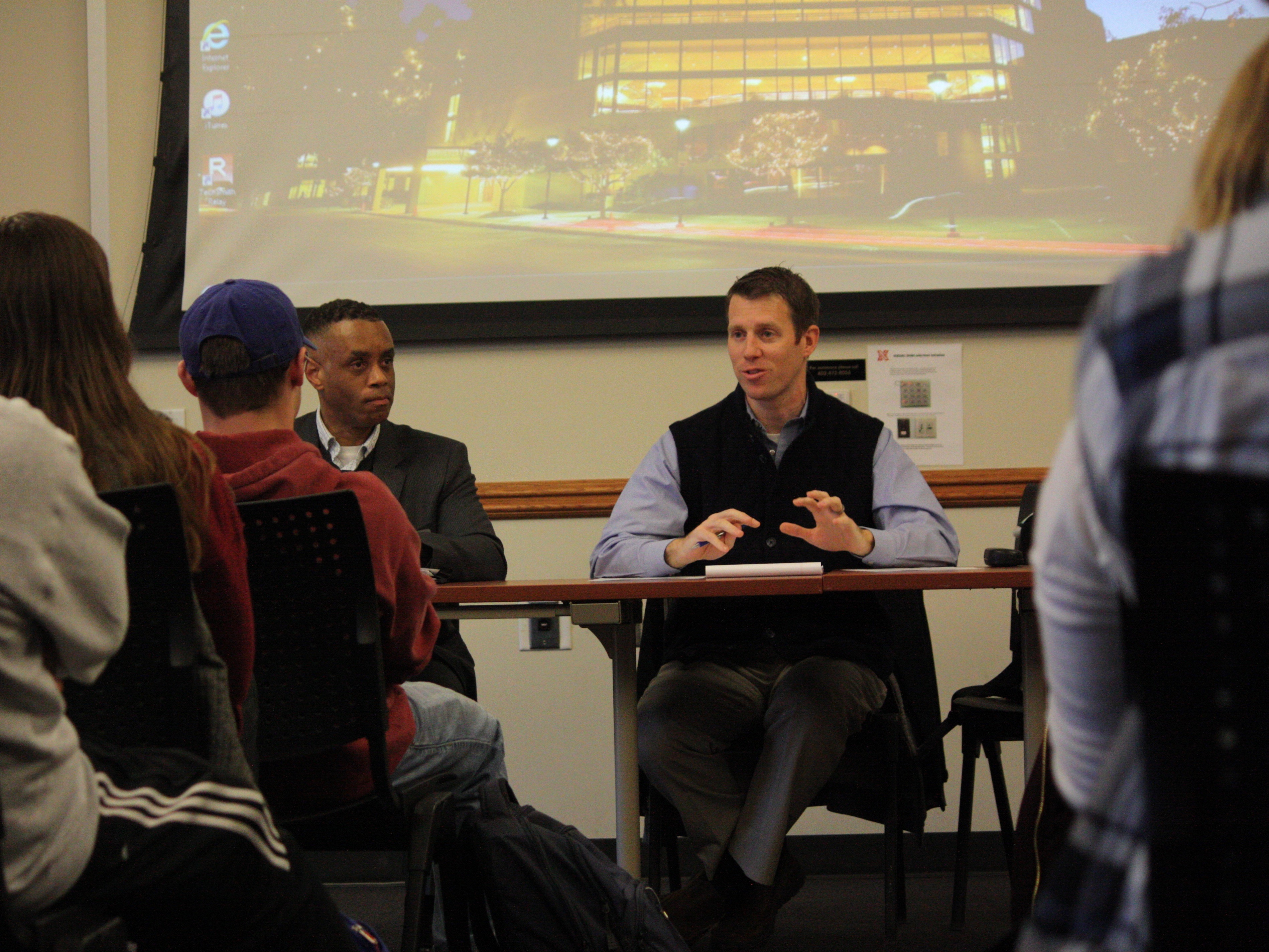 Assistant Chief of Police Hassan Ramzah and Assistant Vice Chancellor for Student Affairs Jake Johnson meet with fraternity and sorority leaders at the University of Nebraska-Lincoln.
