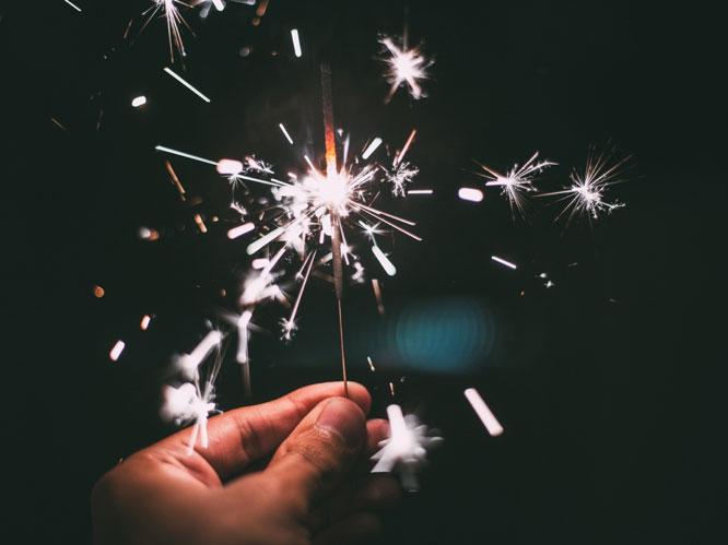 Burning sparkler in a hand