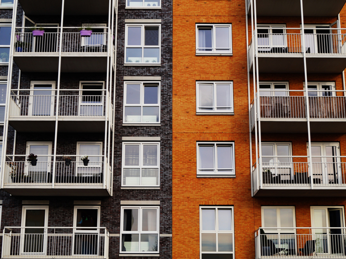 Exterior facade of a multi-story apartment building.