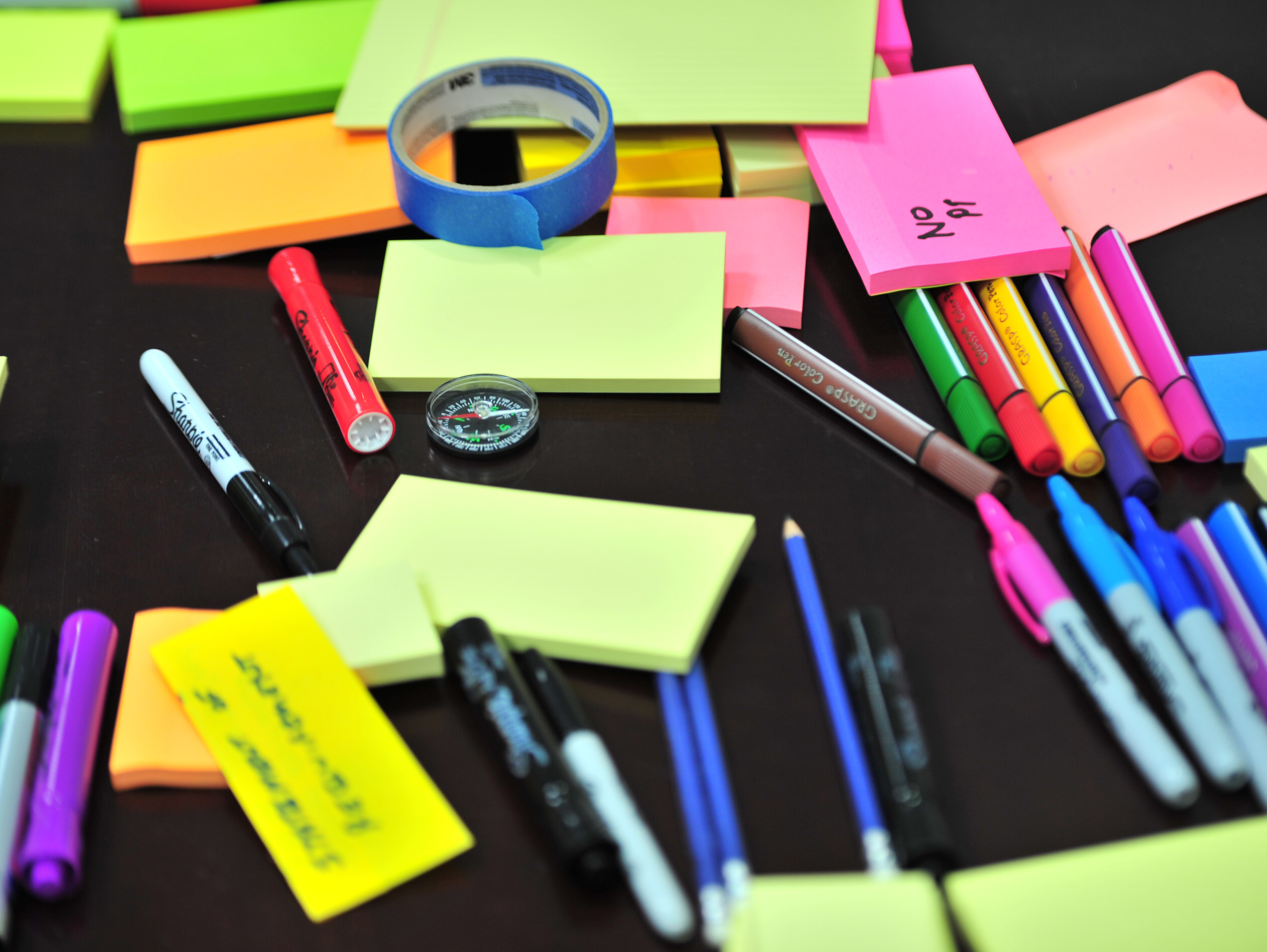 Post-it notes, markers, and pens on a desk. [pexels | photo by frans-van-heerden]