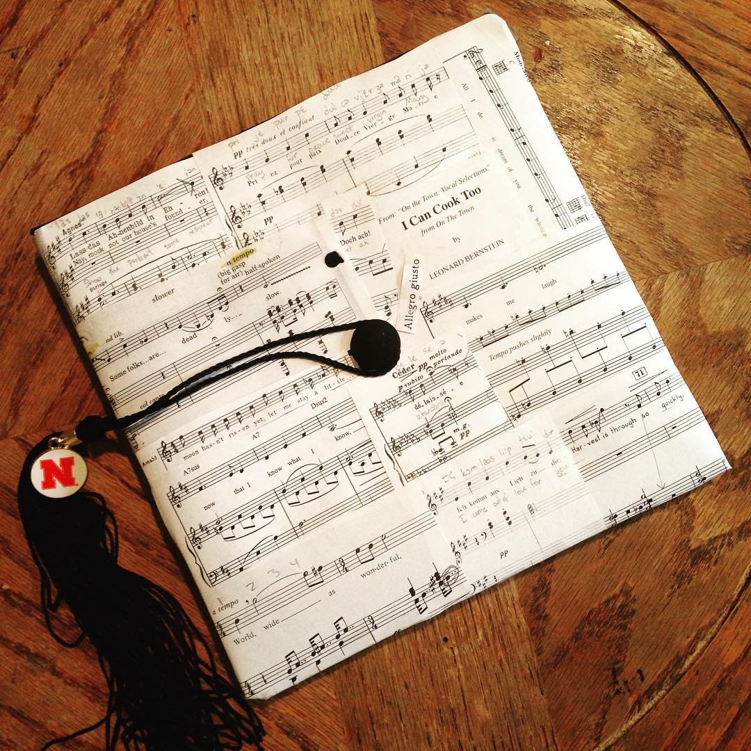 Graduation cap covered in sheet music