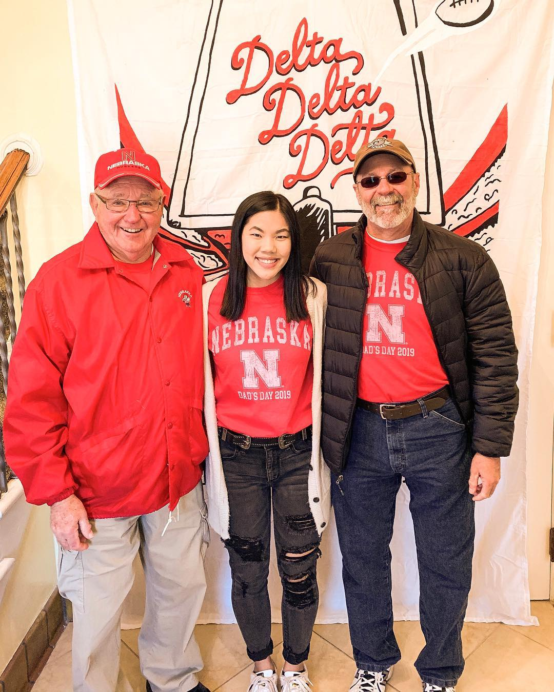 Student with grandpa and uncle at Delta Delta Delta dad's day