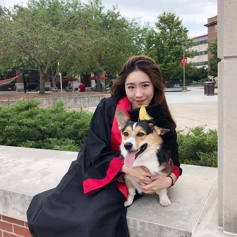 Nebraska summer graduate with dog