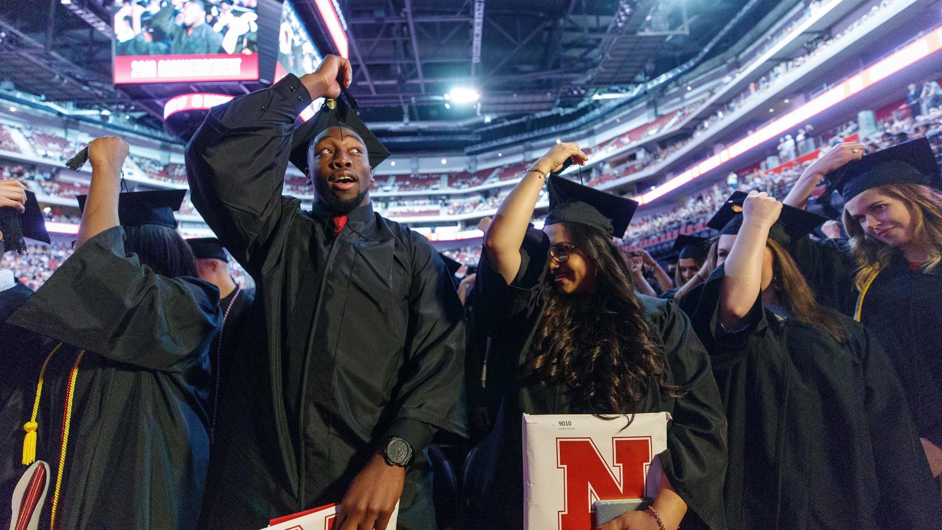 Black student moves tassel at commencement at Nebraska