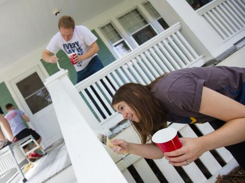 Kate Christensen and Theron Christensen paint porch columns at a house on B Street as part of a citywide Paint-A-Thon Aug. 20, 2016.