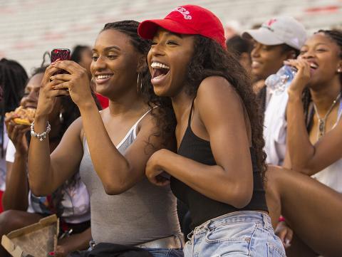 UNL students enjoying an activity in the stands of Memorial Stadium. [Craig Chandler | University Communication]