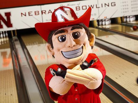 Herbie throws bones in front of the Nebraska bowling alley