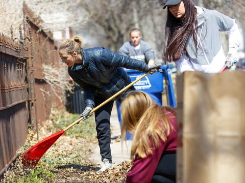 Keeleigh Thayn (in blue jacket) and her Gamma Phi Beta sorority sisters rake leaves along P street during the 2018 Big Event. More than 3,000 students, faculty and staff participated in the day of service.