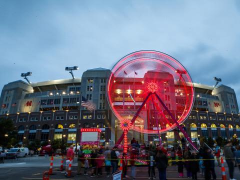 Ferris wheel in front of Nebraska's Memorial Stadium at the homecoming Cornstock festival.