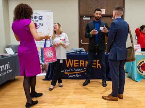 Huskers meet with representatives from Werner Enterprises during the first day of the spring Career Fair. The fair concludes. Feb. 12.