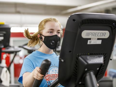 A student exercises on an elliptical machine in the Campus Rec Center at the University of Nebraska-Lincoln. [ Mike Jackson | Student Affairs ]