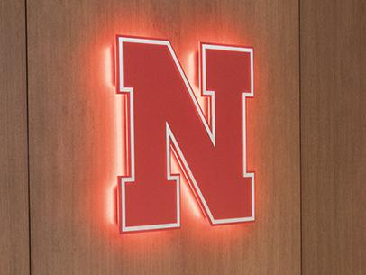 UNL's N-icon is illuminated largely on the wall in the Nebraska East Union.