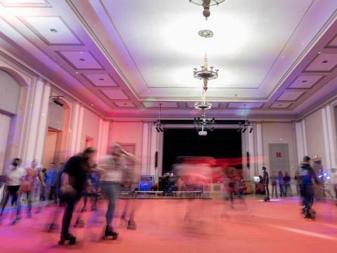 Students roll around the Nebraska Union Ballroom during the Club 80 roller skating event in the Nebraska Union Ballroom on Feb. 19. The event was hosted by Student Involvement. (photo by Jordan Op | for University Communications)