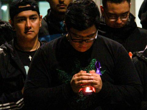 A student at the University of Nebraska-Lincoln holds a candle during the Take Back the Night candlelight vigil outside the Nebraska Union on Tuesday, Oct. 9, 2018, in Lincoln, Nebraska. | Daily Nebraskan, Photo by Johnna Sisneros