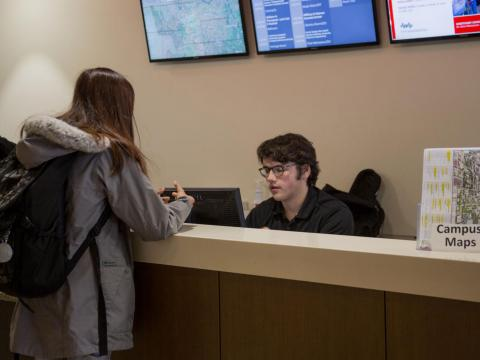 A worker at the welcome desk in the Nebraska Union at the University of Nebraska-Lincoln answers a student's question on Wednesday, Jan. 9, 2019, in Lincoln, Nebraska. | Daily Nebraskan