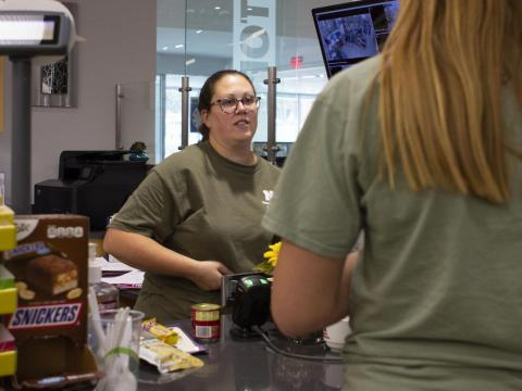 C-Store employee Becky Rowley scans food items for a UNL student at the Cather C-Store on Thursday, Sept.12, 2019, in Lincoln, Nebraska.