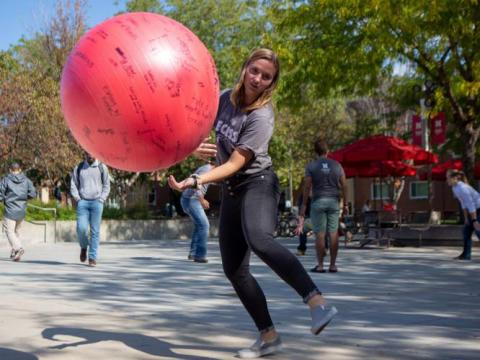 """UNL students bounce a ball outside of the union during Big Red Resilience and Well-Being's """"Recess"""" event on Monday, Oct. 14, 2019, in Lincoln, Nebraska."""