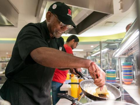 Dining service associate David Webb prepares an omelette inside of the Selleck Dining Hall on Thursday, Nov. 14, 2019, in Lincoln, Nebraska.
