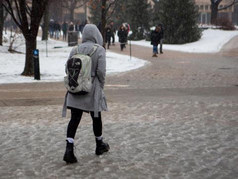 A student walks through the slush outside of the Nebraska Union on Thursday, Jan. 23, 2020, in Lincoln, Nebraska. | Daily Nebraskan