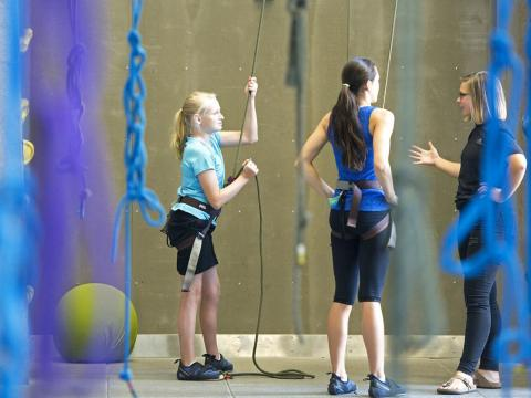 University of Nebraska-Lincoln campus recreation employee and Bright Lights instructor Annie Himes (from right) coaches students Solana Honda and Nicole Marienau during a rock climbing class in 2015 at the UNL Outdoor Adventure Center.