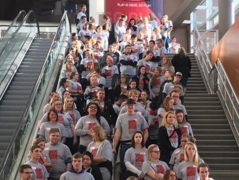 Volunteers gather before the opening of the Project Connect and Standdown inside the Pinnacle Bank Arena in Lincoln, Nebraska.
