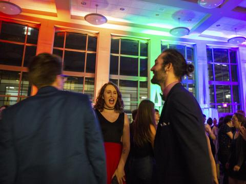 Jake Piccini (center) dances with friends during the Rainbow Ball on Oct. 4 in the Great Hall of the Kauffman Residential Center. The LGBTQA-friendly event is a new homecoming tradition at the University of Nebraska–Lincoln.