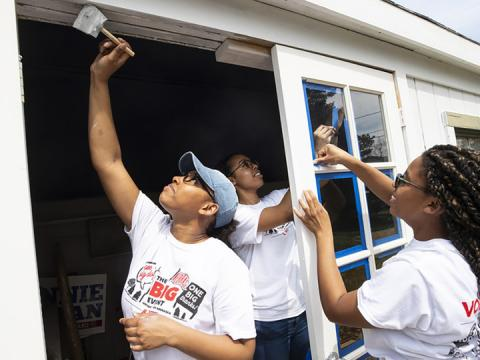 Members of the Minority Pre-Health Association paint a shed and clean up a yard during last April's Big Event.
