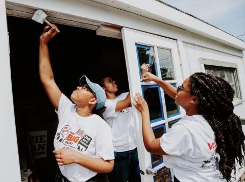 University of Nebraska-Lincoln students volunteer to help paint a home during The Big Event in 2019.