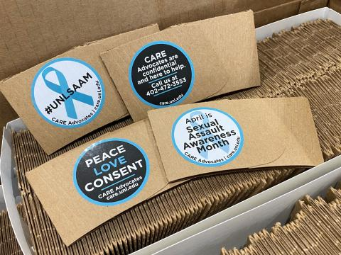 Coffee sleeves with messages promoting Sexual Assault Awareness Month
