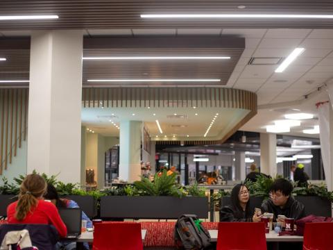Cristal Kwan (left) shows Mike Nguyen (right) her phone in the newly renovated East Campus Union on Monday, March 9, 2020, in Lincoln, Nebraska.