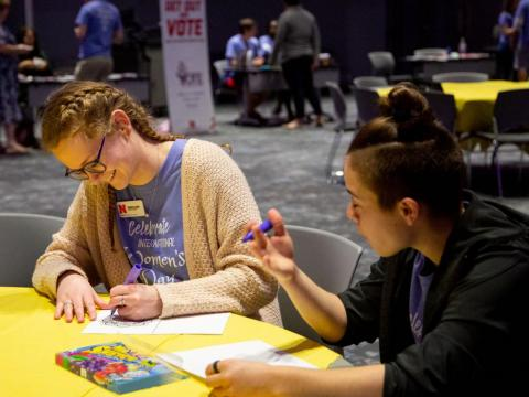 Participants color at the International Women's Day celebration in the Red Cloud Room at Willa Cather Dining Center on Wednesday, March 4, 2020, in Lincoln, Nebraska.