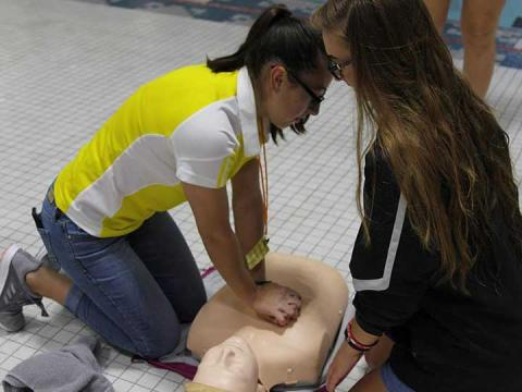 Student employees at Campus Recreation at the University of Nebraska-Lincoln practice CPR skills as part of staff training.