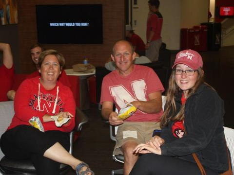 Family members watch the Nebraska football game together at Family Weekend
