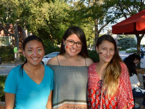 Students with facepaint celebrate Hispanic heritage at Fiesta on the Green at the University of Nebraska-Lincoln.