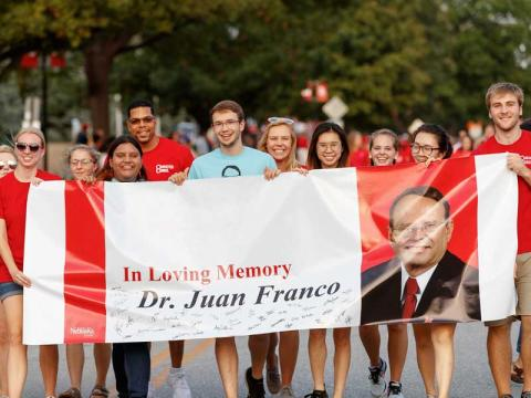Student members of the Character Council march in the homecoming parade at the University of Nebraska-Lincoln to honor Dr. Juan N. Franco.
