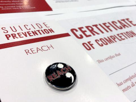 REACH suicide prevention pin and certificate