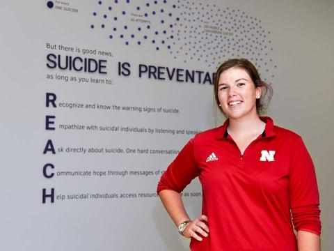 Kate Smith, senior graphic design major from Detroit Lakes, Minnesota, used her artistic talents and background working in mental health to create a display highlighting the importance of suicide prevention and spread the message that even one conversation with a person could save their life.