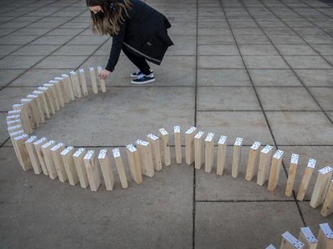 University of Nebraska-Lincoln senior Kateri Hartman, an advertising and public relations major from Wahoo, sets up some of the 70 dominos with the names of students who signed a pledge as part of The Civility Effect on Thursday at the Nebraska Union. As part of the project, five UNL students aim to teach people how to have productive, civil conversations. (FRANCIS GARDLER, Journal Star)
