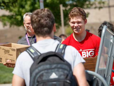 University of Nebraska–Lincoln student Thomas Lilly (right) smiles as he and his roommate, Luke Haberman, carry a futon into Schramm Hall in August 2017. Students at Nebraska will move in from 8 a.m. to 4 p.m. the week of Aug. 13. | University Communication