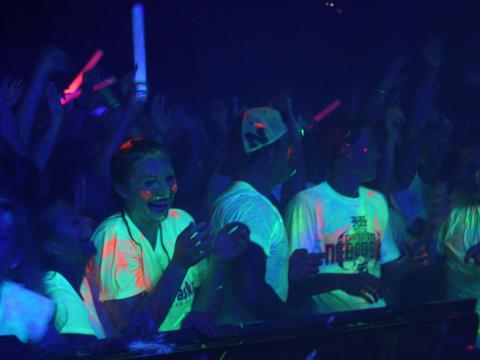 University of Nebraska-Lincoln students dance and enjoy a paint party in the heart of campus